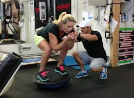 entraîneur avec feme